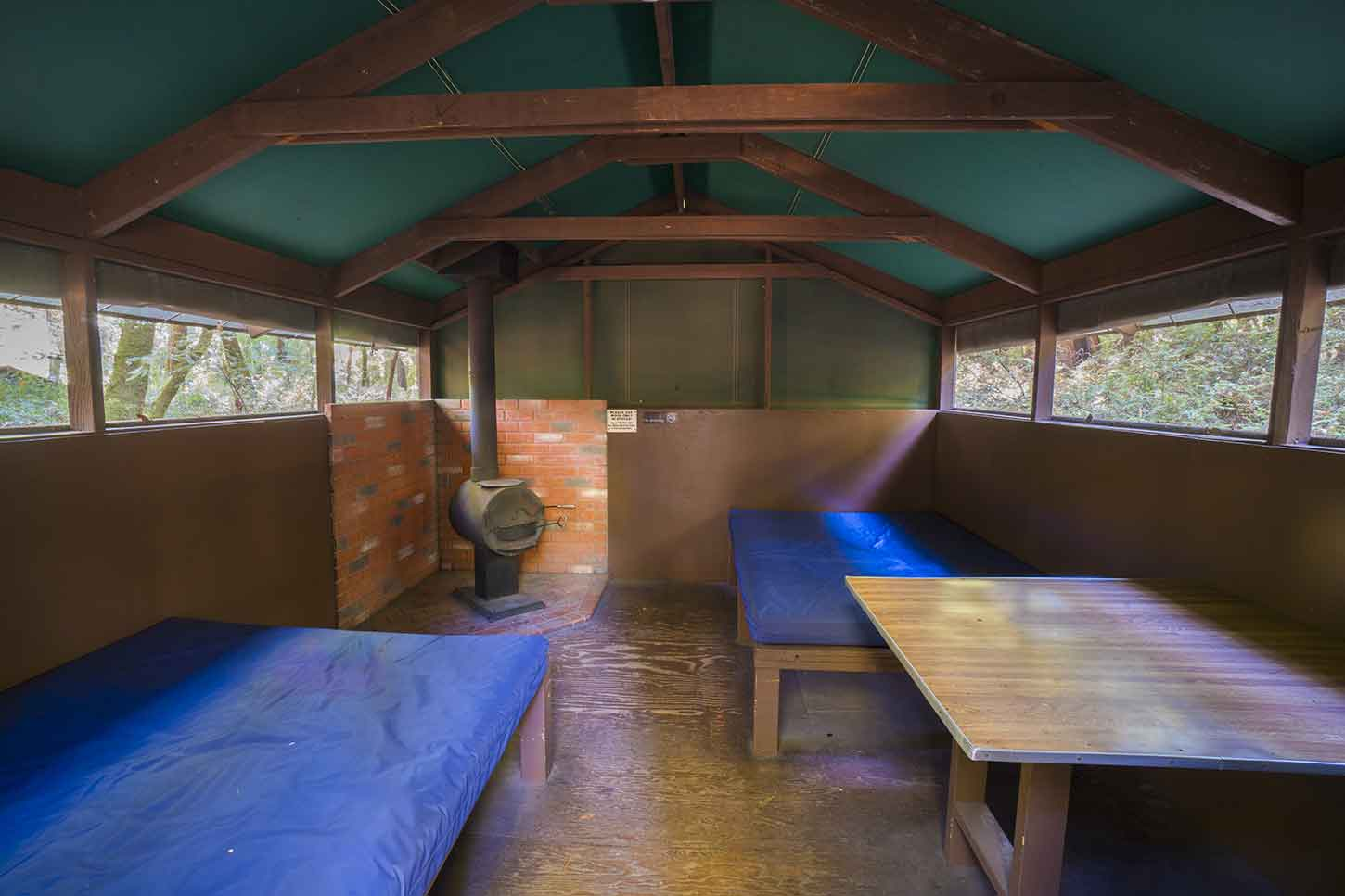Inside a basic cabin & Huckleberry Campground